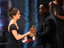 "Alicia Vikander, left, presents Mahershala Ali with the award for best actor in a supporting role for ""Moonlight"" at the Oscars on Sunday, Feb. 26, 2017, at the Dolby Theatre in Los Angeles. (Photo by Chris Pizzello/Invision/AP)"